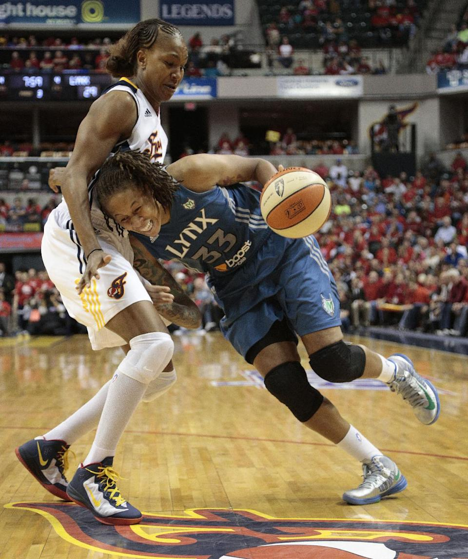 Minnesota Lynx guard Seimone Augustus, right, drives around Indiana Fever forward Tamika Catchings in the second half of Game 3 of the WNBA basketball Finals, Friday, Oct. 19, 2012, in Indianapolis. The Fever won 76-59. (AP Photo/AJ Mast)