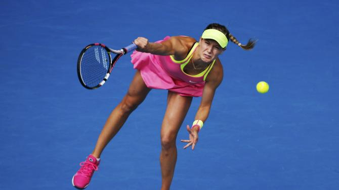 Bouchard of Canada serves to Sharapova of Russia during their women's singles quarter-final match at the Australian Open 2015 tennis tournament in Melbourne