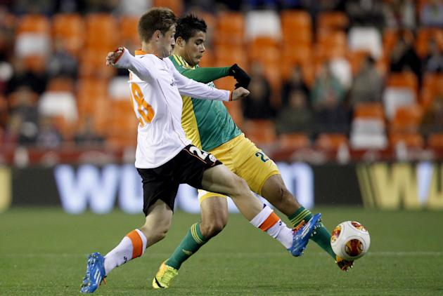 Kuban Krasnodar's Anton Sosnin, right, duels for the ball with Valencia's Andres Guardado, during their  Europa  League Group A soccer match at the Mestalla stadium in Valencia, Spain, Thursda
