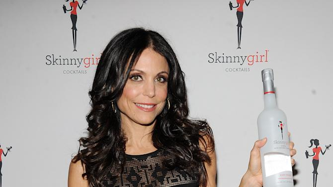 """FILE - This Oct. 12, 2012 file photo originally released by Skinnygirl Cocktails shows TV personality Bethenny Frankel at the Skinnygirl Cocktails event during the New York City Wine & Food Festival in New York. Frankel plans to expand her Skinnygirl line of wine and spirits and power bars to include more food products. Frankel, whose entrepreneurial reach also includes diet books and videos, and a novel, had a six-city run of """"bethenny"""" on Fox-owned stations last year. The show will air in cities across the country this fall.  (AP Photo/Skinnygirl Cocktails, Scott Gries)"""