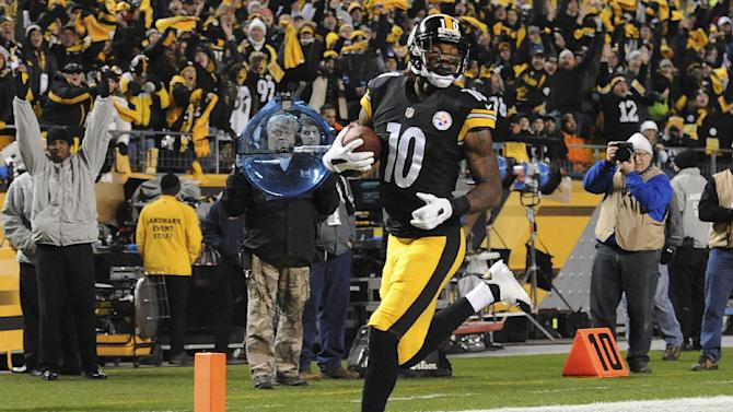 Steelers win AFC North but lose Bell to injury