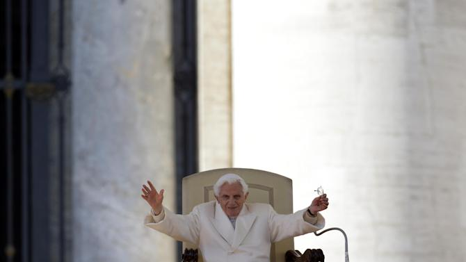 "Pope Benedict XVI waves to faithful during his final general audience in St.Peter's Square at the Vatican, Wednesday, Feb. 27, 2013. Pope Benedict XVI has recalled moments of ""joy and light"" during his papacy but also times of great difficulty in an emotional, final general audience in St. Peter's Square before retiring. (AP Photo/Gregorio Borgia)"