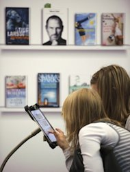 "File illustration photo shows women using an iPad in Germany. Experts at a panel discussion in New York last month entitled ""Baby Brains and Video Games"" urged parents to set limits on electronic device use -- while acknowledging the magnetic appeal of iPads in particular"