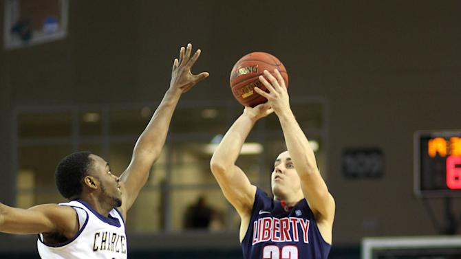 Liberty's John Caleb Sanders (33) shoots a jump shot over Charleston Southern's Jeremy Sexton (10) during the  first half of an NCAA college basketball game in the championship at the Big South Conference tournament on Sunday March 10, 2013 in Conway, S.C. (AP Photo/Willis Glassgow)