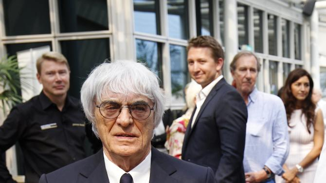 Formula One commercial supremo Bernie Ecclestone arrives for an event at a hotel ahead of the Singapore F1 Grand Prix at the Marina Bay street circuit in Singapore