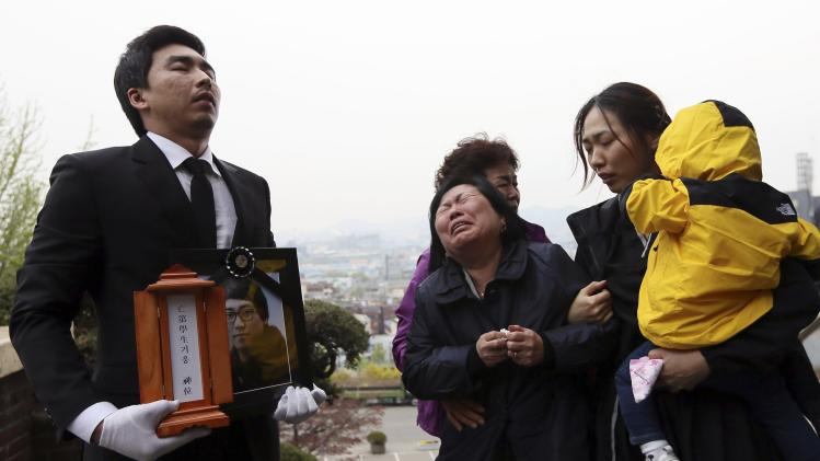 "Family members of a passenger who died on South Korean ferry ""Sewol"" which sank off Jindo, cry during his funeral in Incheon"