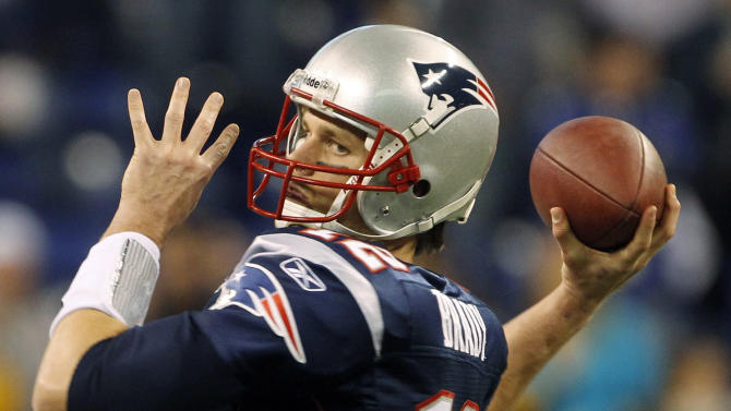 New England Patriots quarterback Tom Brady warms up before the NFL Super Bowl XLVI football game against the New York Giants, Sunday, Feb. 5, 2012, in Indianapolis. (AP Photo/Jeff Roberson)