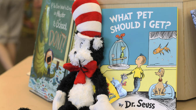 "A plush ""Cat in the Hat"" toy is displayed next to ""What Pet Should I Get?,"" the latest book by Dr. Seuss, on Tuesday, July 28, 2015 at a bookstore in Concord, N.H.  The book, released 24 years after the author's death, includes the same pair of siblings featured in Seuss's 1960 classic ""One Fish Two Fish Red Fish Blue Fish."" (AP Photo/Holly Ramer)"