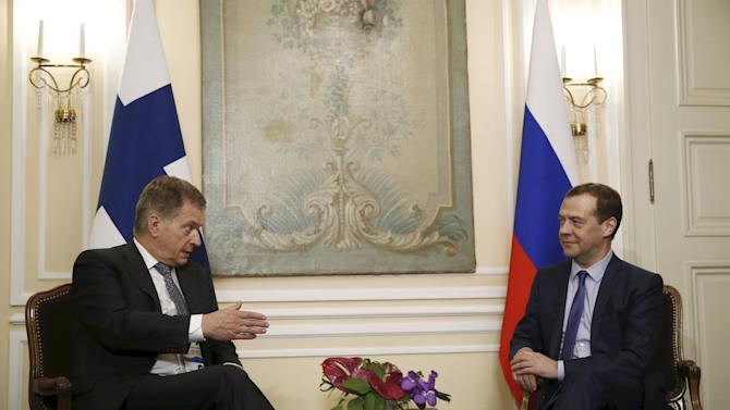 Finnish President Niinisto speaks with Russian PM Medvedev during meeting on sideline of Munich Security Conference in Munich