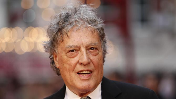 """FILE - In this Sept. 4, 2012 file photo, British playwright Tom Stoppard poses as he arrives for the world premiere of """"Anna Karenina,"""" in London. The Roundabout Theatre Company said Monday, March 5, 2013, that Margulies' Pulitzer Prize-winning play """"Dinner with Friends"""" will be part of its 2013-2014 theatrical season, as will a revival of Tom Stoppard's Tony Award winning play """"The Real Thing."""" (AP Photo/Sang Tan, File)"""