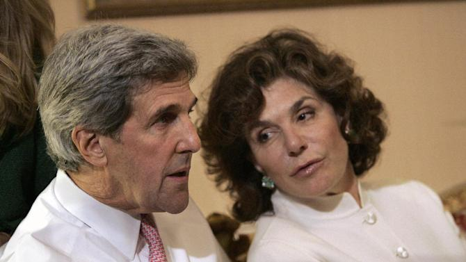 FILE - In a Tuesday, Nov. 4, 2008 file photo, Sen. John Kerry, D-Mass, left, talks with his wife Teresa Heinz Kerry while watching election results at a hotel in Boston, in Boston. A hospital spokesman says Teresa Heinz Kerry is hospitalized Sunday, July 7, 2013 in critical but stable condition in a hospital on the island of Nantucket, Mass. (AP Photo/Michael Dwyer, File)