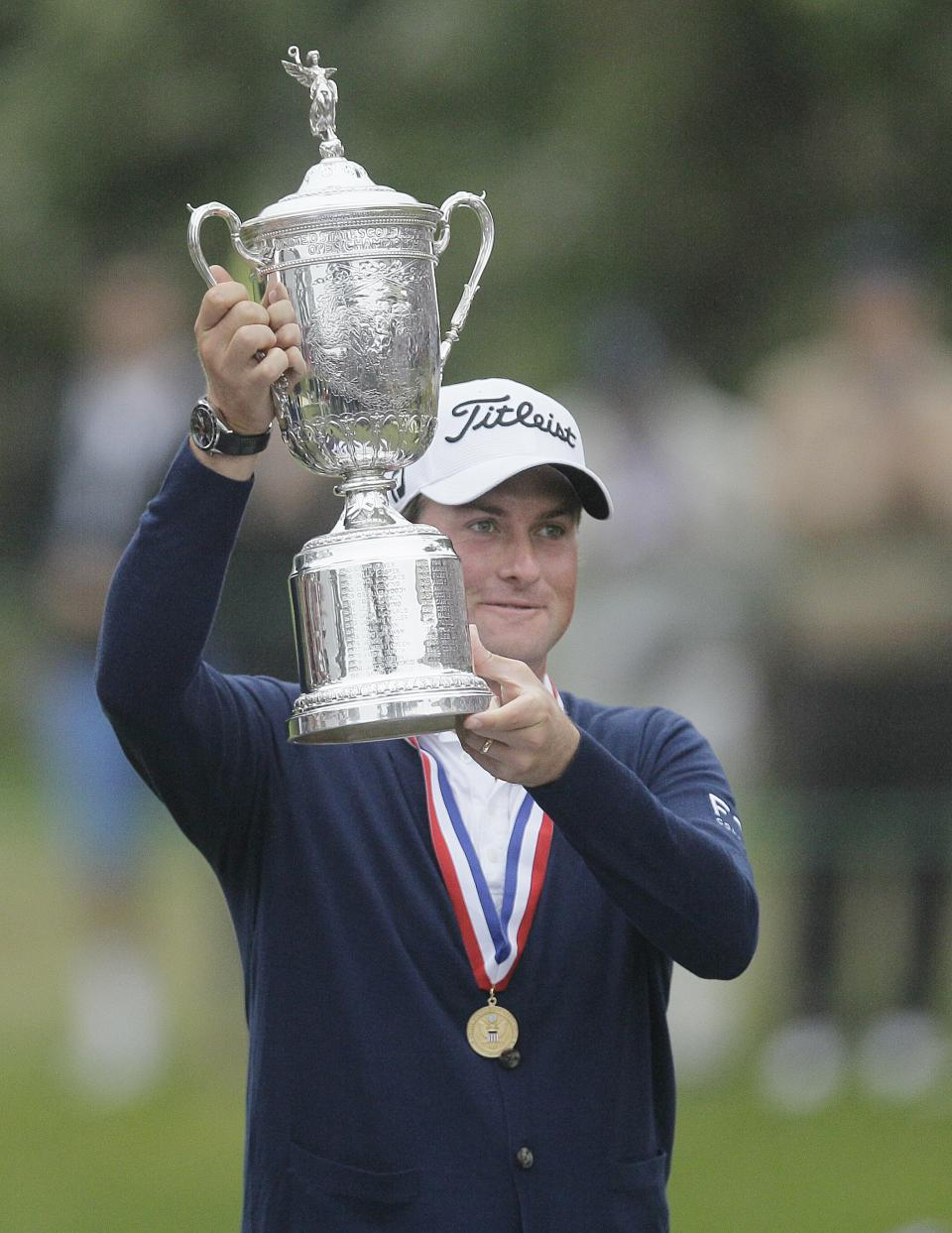 Webb Simpson holds up the championship trophy after the U.S. Open Championship golf tournament Sunday, June 17, 2012, at The Olympic Club in San Francisco. (AP Photo/Eric Risberg)