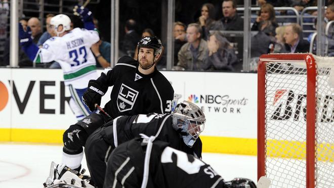 Willie Mitchell #33, Jonathan Quick #32 And Trevor Lewis #22 Of The Los Angeles Kings React To The Goal Of Henrik Getty Images