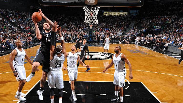 Pierce, Nets win 13th straight at home, top Wolves