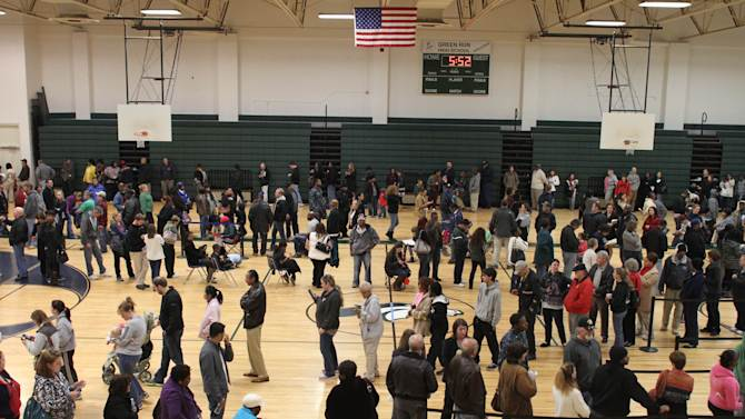 Hundreds of people wait in line to vote at Green Run High School in Virginia Beach, VA., on Tuesday, Nov. 6, 2012.  Some people had to wait longer than four hours to cast their vote at the school.    (AP Photo/The Virginian-Pilot, Ross Taylor)  MAGS OUT