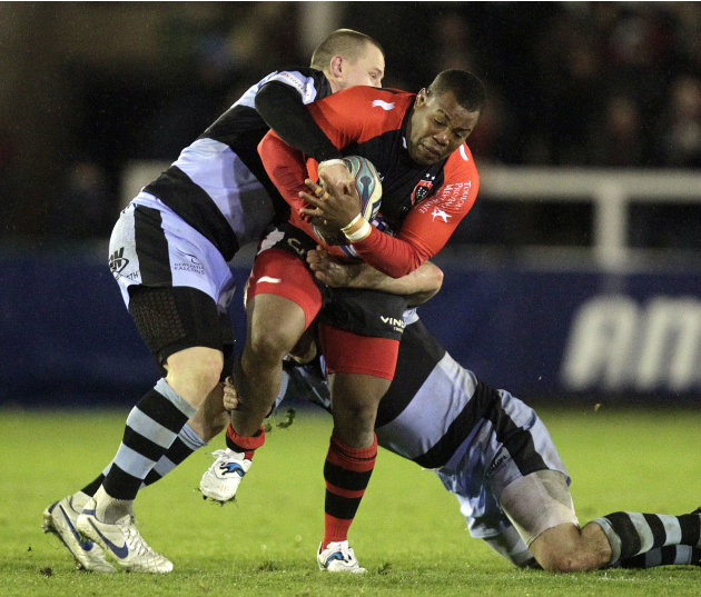 Newcastle Falcons' James Fitzpatrick (L) tackles Toulon's Stefan Armitage (R) during a pool 2, European Challenge Cup rugby union match at Kingston Park, Newcastle upon Tyne on December 8, 2011. AFP P