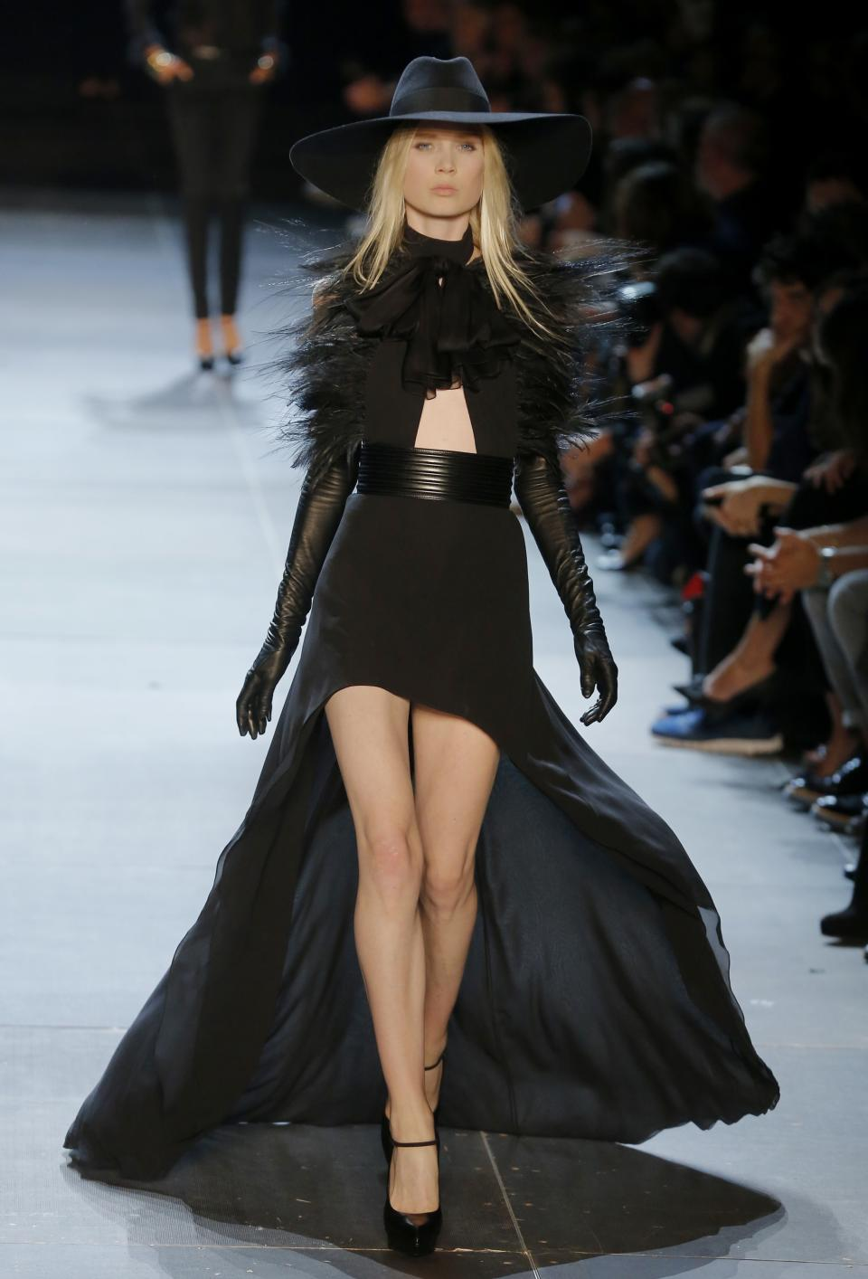 A model wears a creation by  French-born  fashion designer Hedi  Slimane for St Laurent his  ready to wear Spring-Summer 2013 collection presented in Paris, Monday, Oct. 1, 2012. (AP Photo/Jacques Brinon)