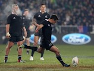 New Zealand All Blacks fly-half Dan Carter kicks a penalty during their rugby union match against Ireland at AMI Stadium in Christchurch on June 16. New Zealand snatched a 22-19 victory over Ireland with a desperate 79th minute goal by Carter as a bruising rugby Test reached a nail-biting finish on Saturday