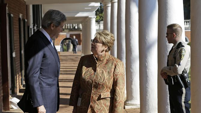 Secretary of State John Kerry talks with University of Virginia President Theresa Sullivan along the colonnade of the school, Wednesday, Feb. 20, 2013, in Charlottesville, Va. Kerry was to deliver his first foreign policy speech about the value of President Obama's investments in a strong foreign policy.  (AP Photo/Steve Helber)