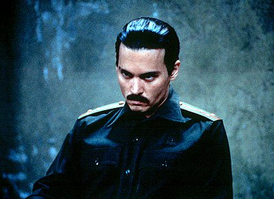 Johnny Depp as Lieutenant Victor/Bon Bon in Fine Line's Before Night Falls