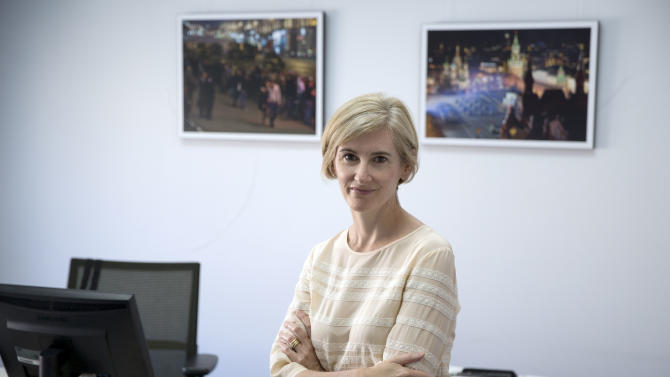 Caro Kriel, currently The Associated Press' news director for Russia and the Commonwealth of Independent States, poses for a photo in her office in the AP Bureau in Moscow, Tuesday, May 27, 2014. Kriel has been appointed as Europe news director for the news cooperative. She will be based in London and oversee 250 AP journalists in text, photos and video for a region stretching from the western shores of the British Isles to the Russian far east and from Iceland in the north to southern Portugal. (AP Photo/Pavel Golovkin)