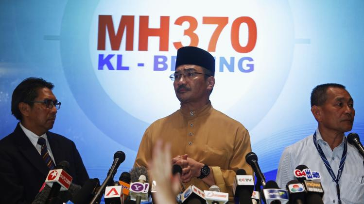 Malaysia's acting Transport Minister Hishammuddin Tun Hussein takes questions from journalists during news conference about missing Malaysia Airlines flight MH370, at Kuala Lumpur International Airport