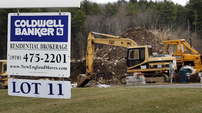 In this Thursday, Dec. 20, 2012 photo, a sign hangs in North Andover, Mass., where a house is under construction. Sales of new U.S. homes cooled off in December compared with November, but sales for the entire year were the best since 2009. The Commerce Department said Friday, Jan. 25, 2013, that new-home sales fell 7.3 percent last month to a seasonally adjusted annual rate of 369,000. That's down from November's rate, which was the fastest in 2 ½ years. (AP Photo/Elise Amendola)