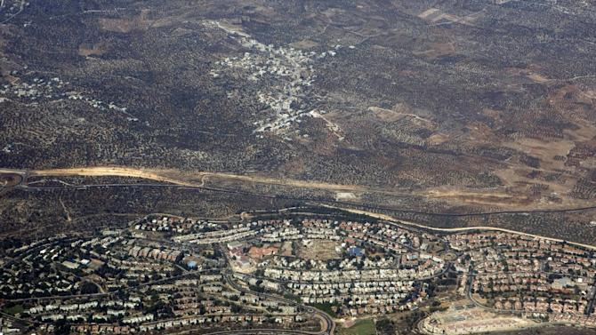 FILE - In this Sept. 20, 2010 aerial file photo, taken through the window of an airplane, the West Bank Jewish settlement of Ariel is seen. The Israeli branch of McDonald's says it won't open a restaurant in a Jewish settlement to protest Israel settlement policy. Irina Shalmor, spokeswoman for McDonald's Israel, said the owners of a planned mall in the Ariel settlement asked McDonald's to open a branch there about six months ago (AP Photo/Ariel Schalit, File)