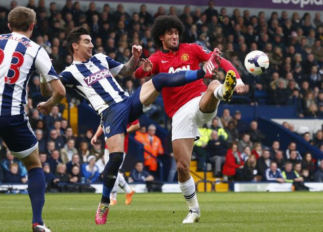 West Bromwich Albion's Ridgewell challenges Manchester United's Fellaini during their English Premier League soccer match at The Hawthorns in West Bromwich