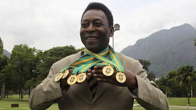 Brazilian soccer legend Pele shows off his six domestic championship medals at a Brazilian soccer confederation event recognising the previous incarnations of the Brazilian soccer championships in Rio de Janeiro (Reuters)