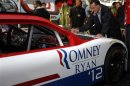 Romney autographs a racecar at the Federated Auto Parts 400 NASCAR Sprint Cup Series race in Richmond
