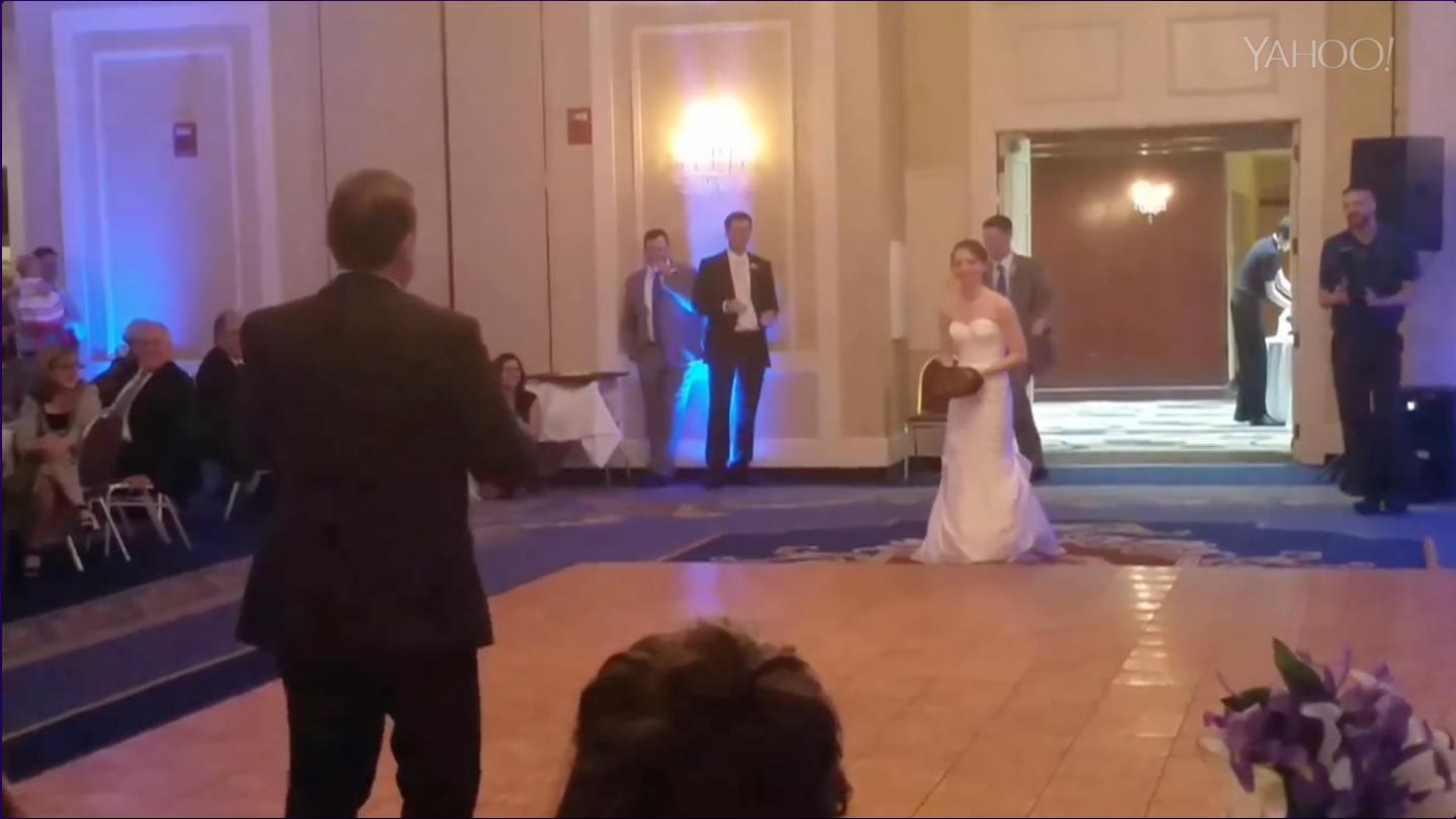 Dad stops father-daughter dance for a game of catch