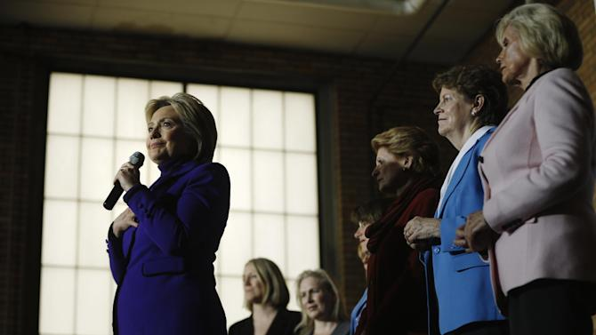 Democratic presidential candidate Hillary Clinton, accompanied by, from right, Lilly Ledbetter, right, Sen. Jeanne Shaheen, D-N.H., Sen. Debbie Stabenow, D-Mich., Sen. Amy Klobuchar, D-Minn., and others, speaks during a campaign stop, Friday, Feb. 5, 2016, in Manchester, N.H. (AP Photo/Matt Rourke)