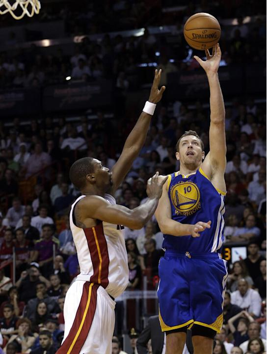 Golden State Warriors' David Lee (10) shoots as Miami Heat's Chris Bosh defends during the second half of an NBA basketball game, Thursday, Jan. 2, 2014, in Miami. The Warriors defeated the He