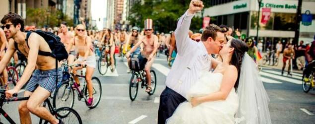 Newlyweds join nude cyclists for wedding photos