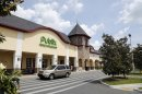 A vehicle passes the front of the Publix supermarket in Zephyrhills, Fla., Sunday, May 19,&#8230;</p>