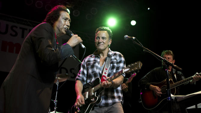 Bruce Springsteen, center, performs with Alejandro Escovedo, left, and Joe Ely at the Austin Music Awards at the Austin Music Hall during SXSW on Wednesday March 14, 2012 in Austin, Texas. (AP Photo/Austin American-Statesman, Jay Janner)  MAGS OUT; NO SALES; INTERNET AND TV MUST CREDIT PHOTOGRAPHER AND STATESMAN.COM