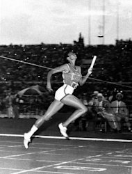 USA's Wilma Rudolph, Clarksville, Tenn., hits the tape to win the gold medal in the women's 4 x 100-meter relay at the Summer Olympics in Rome, Sept. 8, 1960.