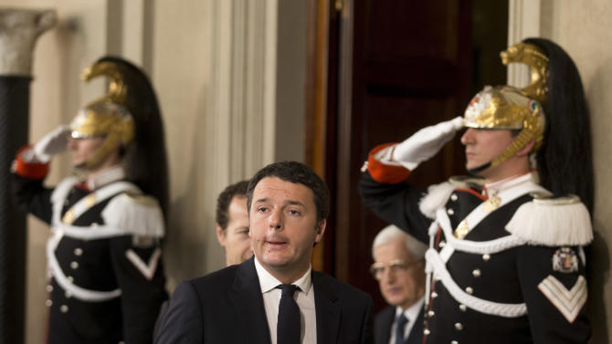 Cuirassiers presidential guards salute as Italian Democratic Party's leader Matteo Renzi arrives to meet journalists at the Quirinale presidential palace after talks with Italan President Giorgio Napolitano, in Rome, Monday, Feb. 17, 2014. Renzi was asked to form a new government to replace the one he sacked through a stunning power-grab within his own party. Renzi drove himself to his meeting with Napolitano, mimicking the down-to-earth approach of his predecessor, Enrico Letta.(AP Photo/Alessandra Tarantino)