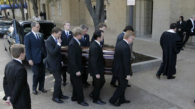 Pallbearers carry Van Cliburn's coffin into Broadway Baptist Church for a funeral service for in Fort Worth, Texas on Sunday, March 3, 2013. The internationally famous musician died this week. About 1,400 people attended a memorial service for Cliburn, who died Wednesday at 78 after fighting bone cancer. As the service began, the Fort Worth Symphony Orchestra accompanied a choir as pall bearers carried his flower-covered coffin into the Fort Worth church. (AP Photo/Star-Telegram, Ron T. Ennis, Pool)