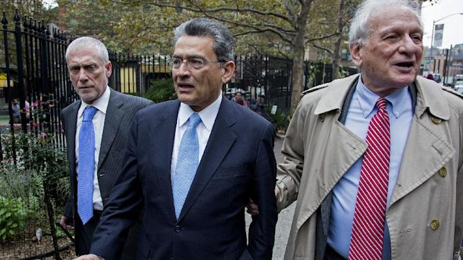 Former Goldman Sachs and Procter & Gamble Co. board member Rajat Gupta, center, arrives outside court in New York Wednesday, Oct. 24, 2012. Gupta is to be sentenced after being found guilty insider trading by passing secrets between March 2007 and January 2009 to a billionaire hedge fund founder who used the information to make millions of dollars. At right is Gupta's attorney Gary Naftalis. (AP Photo/Craig Ruttle)