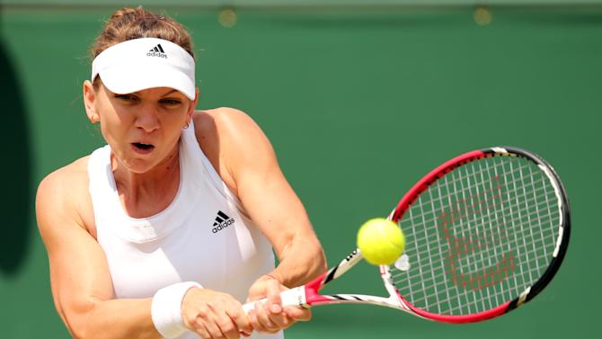 Romania's Simona Halep returns to Kazakhstan's Zarina Diyas during their fourth round match on day eight of the 2014 Wimbledon Championships at The All England Tennis Club in southwest London, on July 1, 2014