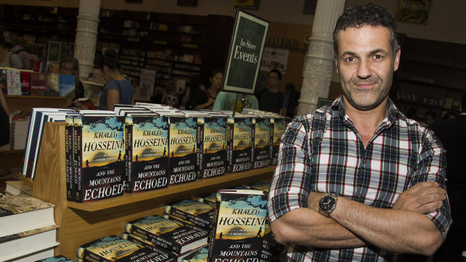 """Author Khaled Hosseini, author of """"And the Mountains Echoed,"""" poses for a photo before a book signing event at Barnes & Noble on Tuesday, May 21, 2013 in New York. (Photo by Charles Sykes/Invision/AP)"""