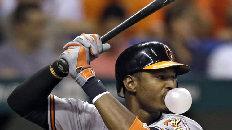 Baltimore Orioles' Adam Jones blows a bubble as he bats against Tampa Bay Rays starting pitcher Jeremy Hellickson during the fourth inning of a baseball game Wednesday, Oct. 3, 2012, in St. Petersburg, Fla. (AP Photo/Chris O'Meara)