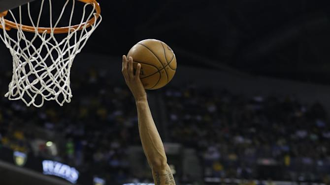 Indiana Pacers' George Hill (3) shoots as Atlanta Hawks' Ivan Johnson (44) watches during the second half of Game 5 in the first round of the NBA basketball playoff series on Wednesday, May 1, 2013, in Indianapolis.  (AP Photo/Darron Cummings)