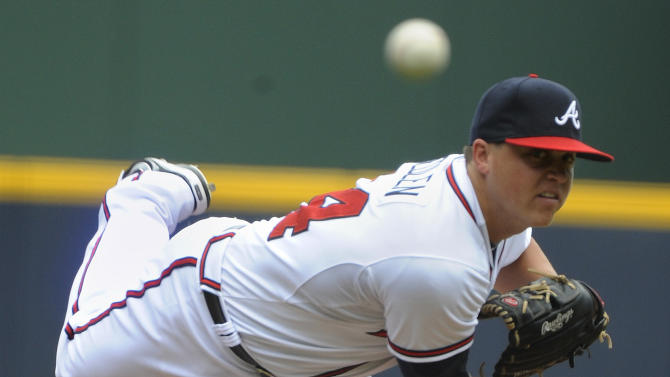 FILE - In this Sept.3,  2012, file photo, Atlanta Braves' Kris Medlen pitches against the Colorado Rockies during the first inning of a baseball game in Atlanta. Former Atlanta right-hander Medlen has agreed to an $8.5 million, two-year contract with the Kansas City Royals after missing last season while he recovered from Tommy John surgery. Medlen will make $2 million next year and $5.5 million in 2016 under the agreement announced Thursday, Dec. 18, 2014, and  could earn up to $10 million in performance bonuses based on starts and innings. (AP Photo/John Amis, File)