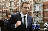 "Former Downing Street communications chief Andy Coulson leaves the High Court on May 10. David Cameron received a text message from one of Rupert Murdoch's closest aides saying they were ""in this together"", a British press ethics inquiry heard during testimony from the prime minister"