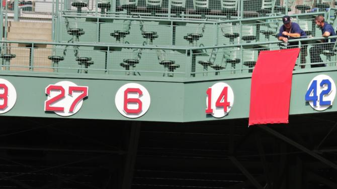 A drape covers the number 45 of Boston Red Sox Hall of Fame pitcher Pedro Martinez prior to a baseball game against the Chicago White Sox at Fenway Park in Boston, Tuesday, July 28, 2015. Martinez's jersey number will be retired, and hang between Red Sox's Jim Rice's #14 and baseball's Jackie Robinson's #42, in a ceremony before the game. (AP Photo/Charles Krupa)