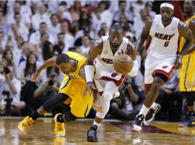 Miami Heat's Dwyane Wade steals the ball from Indiana Pacers' George Hill during Game 1 of their NBA Eastern Conference final basketball playoff in Miami