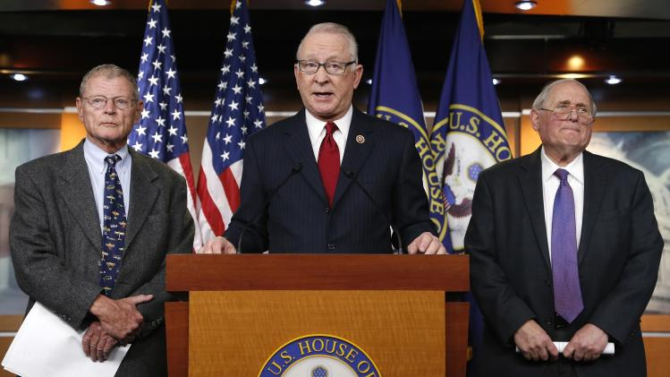 McKeon and Levin, chairmen of the House and Senate Armed Services Committees, with Inhofe, hold a news conference to talk about progress between the two chambers on the National Defense Authorization Act for fiscal year 2014, at the U.S. Capitol in Washing